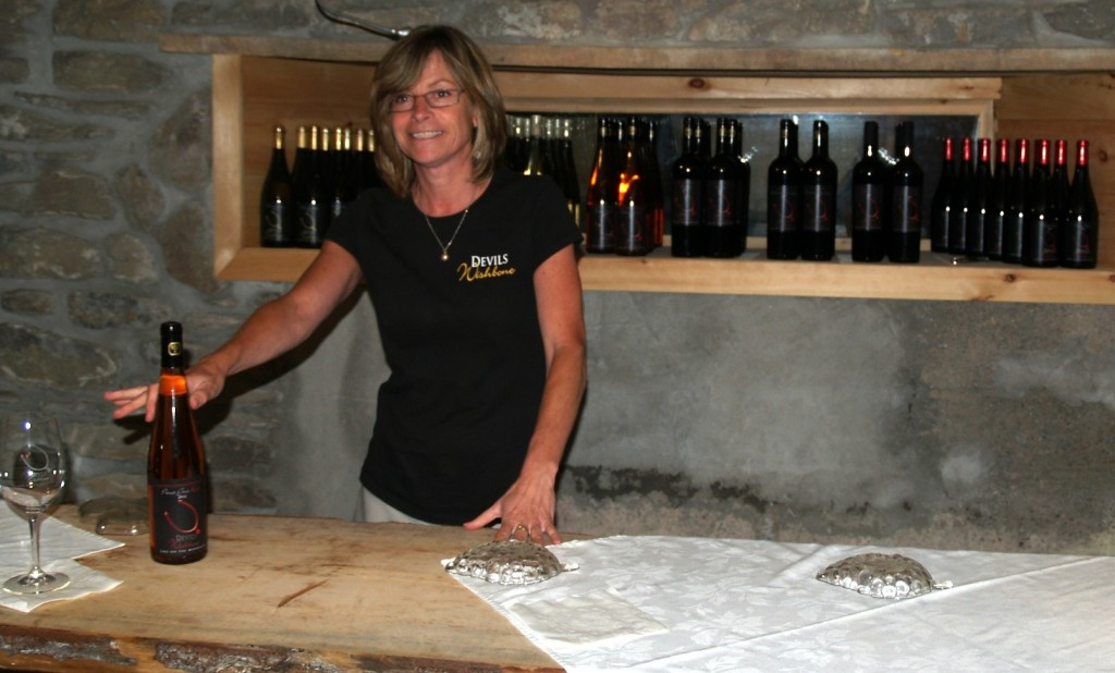 Jennifer pouring at the Devil's Wishbone tasting bar at the winery