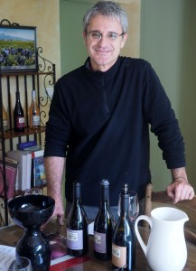 Eric Saurel, owner and vigneron of Montirius, showing off some of his wines